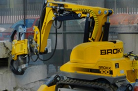 yellow brokk demolition machine